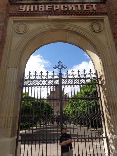 Tony outside the university's main gates.