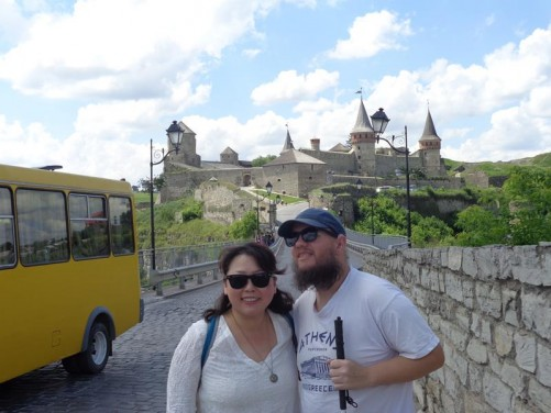 Tony with Barbara who was visiting from Hong Kong. Behind a bridge over the Smotrich River gorge and the castle beyond.