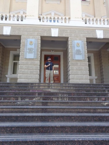 Tony at the top of steps outside the main entrance to the Ministry of Internal Affairs on Ștefan cel Mare Boulevard.