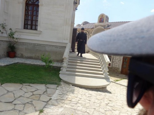 A monk emerging from the church.