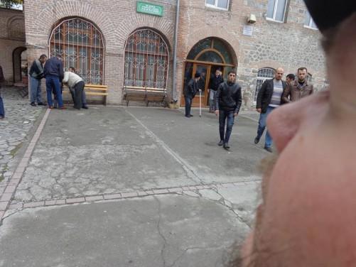 Men leaving the mosque following prayer.