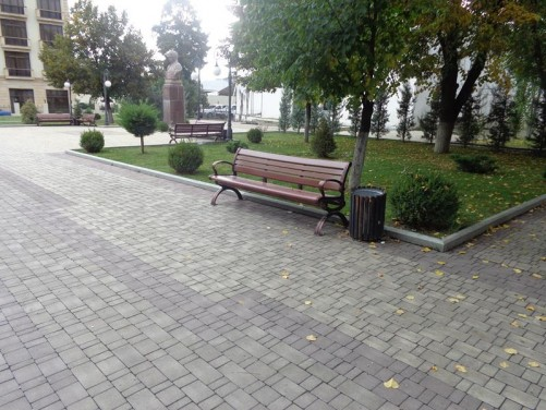 A public park. Just visible in front, a bust of Mirza Fatali Akhundov (1812-1878): a celebrated Azerbaijani author, playwright and philosopher.