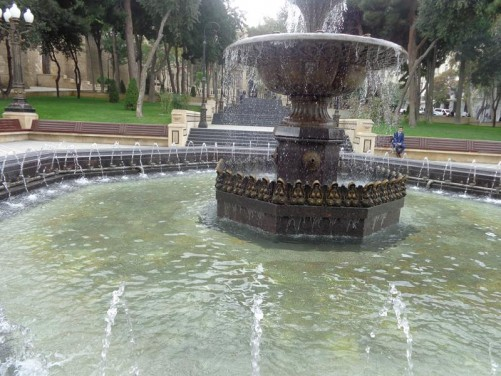 Another closer view of the fountain. A series of flights of steps heading up through the park beyond.