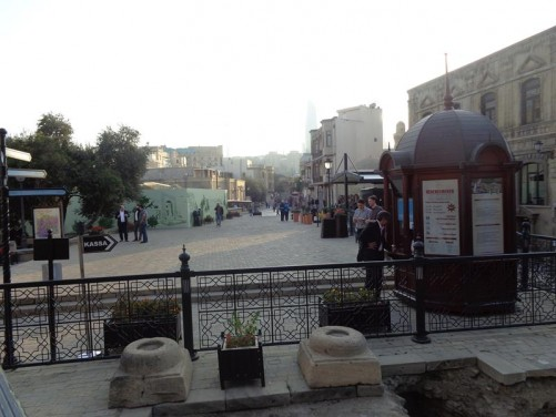 Pedestrian street close to the Palace of the Shirvanshahs lined with old buildings.