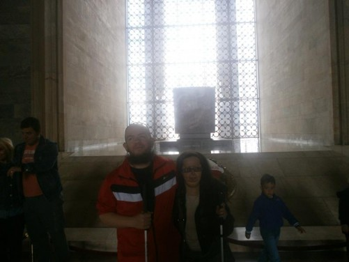 Tatiana and Tony inside the Hall of Honour. Atatürk's sarcophagus can be seen standing on a raised platform. The 40-tonne sarcophagus is symbolic, with Atatürk's actual tomb located below. The Hall of Honour is 41.6 metres by 57.3 metres in area and is 17 metres in height.
