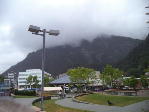 Marine Park next to the harbour. Downtown Juneau in front with the cloud covered Mount Roberts rising steeply beyond. Juneau is surrounded by mountains, the extremely rugged terrain means that despite being the state capital, the city is not connected to the rest of Alaska by road.