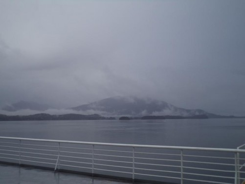 Another view of a mountain mostly visible amongst the scattered cloud and mist.