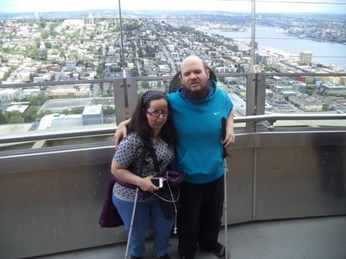 Tony and Tatiana on the Sky Needle's observation deck. An extensive view of the city spread out below, including Lake Union.