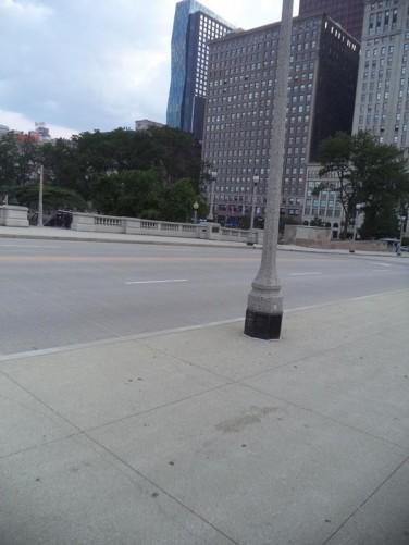 Facing west across the railway bridge towards Metropolitan Tower and the McCormick Building.