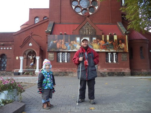 Tony outside the Church of Saints Simon and Helena. The small boy in a woolly hat standing alongside is Dominik, son of Tony's friend Aliaksej.