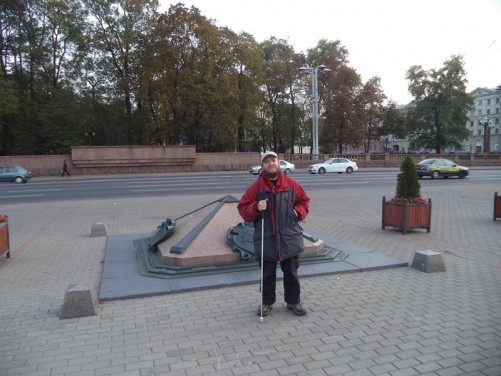Tony in front of a small granite pyramid marking the spot said to be the city centre. October Square (Oktyabrskaya).