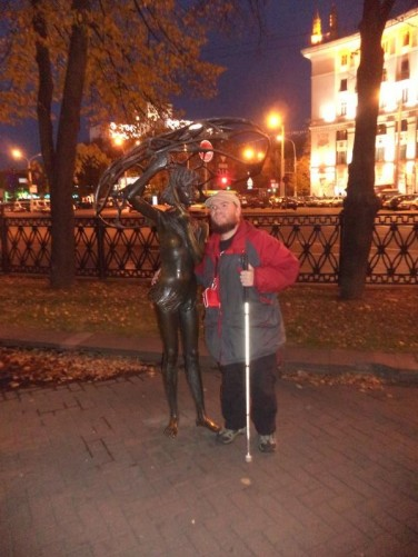 Tony with 'Girl with an Umbrella' statue.