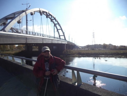 A road bridge over the Mukhavets River close to where it meets the Bug River. Tony on a riverside path.