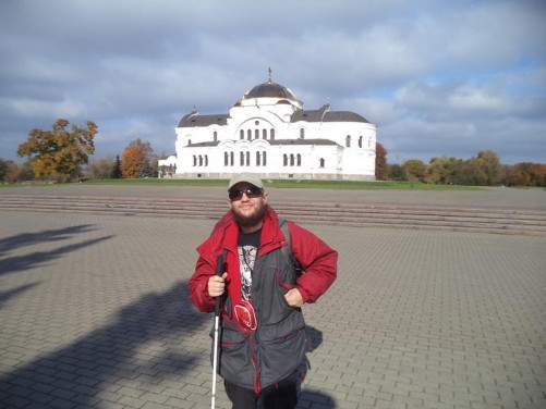 Tony in front of an orthodox church inside Brest Fortress. It is painted white with a central dome. First built in the mid-19th century, it was later reconstructed as a Roman Catholic garrison church (1924-1929) and later held the Red Army Officers Club. During the battles in June-July 1941 the building became an important point of defence and changed hands more than once. It was returned to the Orthodox church in 1994 and is now part of the memorial complex.