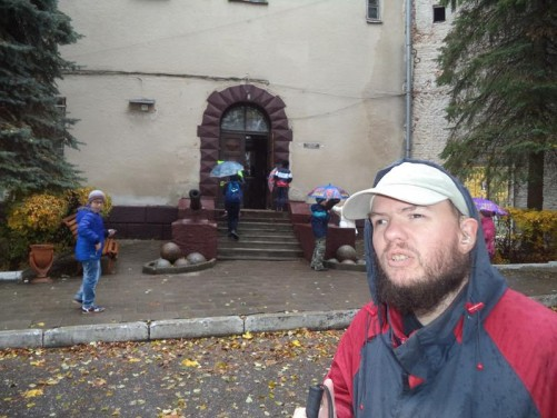 Tony in front of a doorway into the old castle. A pair of old canons and canon balls adorning the steps in front.