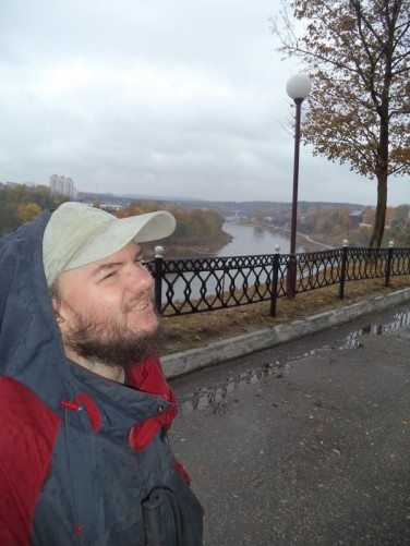 A hazy view looking north-west along the Neman River from close to New Hrodna Castle. Tony in the foreground.