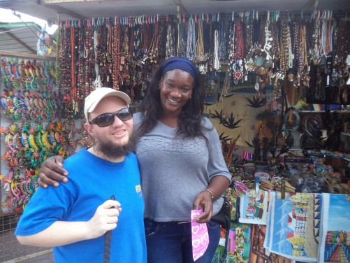 Tony with a sales woman at her market stall selling craft items. Punda, Willemstad.