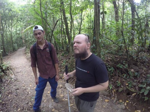 Tony with a local Costa Rican guide on a trail through the forest.