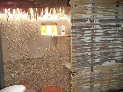 Decorative design created using shells inside the bathroom hut.