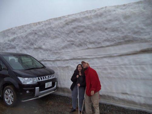 Tony, Tatiana by wall of snow on the way to Zao Okama Crater Lake, Yamagata Prefecture. 26th April.