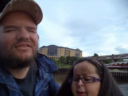 Close-up of Tatiana and Tony by the River Tyne. The High Level Bridge in view to the side.