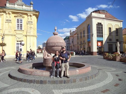 Tony, Tatiana in front of the Orb and its fountain, Varoshaz Ter (City Hall Square). This is in the main square of Szekesfehervar.
