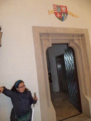 Tatiana standing in a doorway located in the upper rooms of the castle.