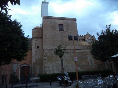 Café tables in Plaza de la Alfala. Behind is Iglesia San Isidoro (St. Isidoro Church)