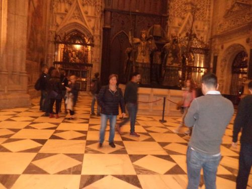 The tomb of Christopher Columbus inside Seville Cathedral. Four figures hold the tomb aloft from a stone base. The figures represent the four kingdoms of Spain during Columbus's life (Castille, Aragon, Navara, and Leon). This tomb was only erected in 1892 when Columbus's remains were moved from Havana, Cuba.