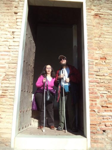 Tatiana and Tony standing in a doorway at the Generalife.
