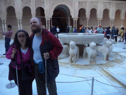 The Court of the Lions. Tony and Tatiana in front of the 12 lion statues, which are laid out in a circle supporting a 12-sided fountain pool above.
