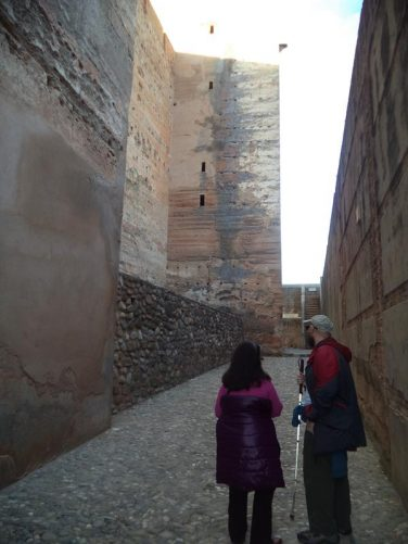 The Alcazaba (Military quarter). Tony and Tatiana on a path between high stone walls. This fortress is one of the oldest parts of the Alhambra.