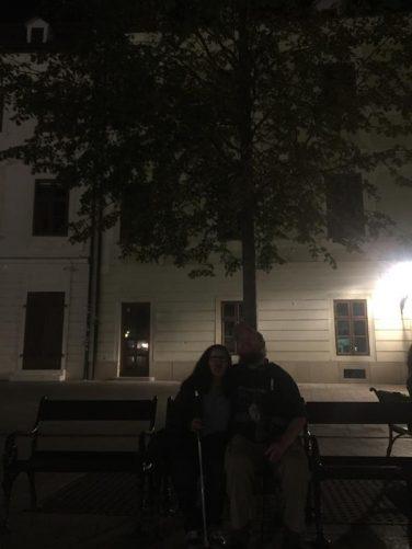 Tatiana and Tony sitting on a bench under the tree in semi-darkness. Here Tony and Tatiana said goodbye to Viktoria.