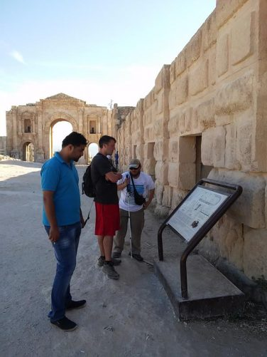Tony next to an information board. A passageway into the hippodrome is just visible to the right. The Hippodrome was once used for chariot races and other sports. It is 244 metres long and once had seating for 15,000 spectators.