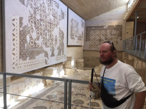 Mosaics made up of geometric patterns mounted on the wall.