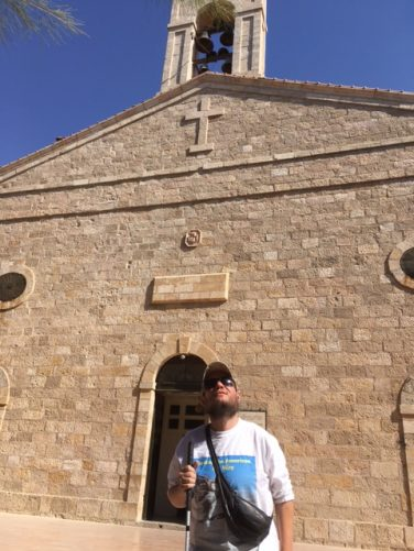 Tony outside the modest front stone façade of St George Church.