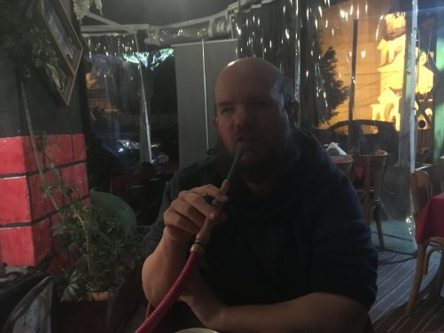 Tony smoking from a Shisha pipe at C'Bon Cafe, Geitawi Neighbourhood, Beirut.