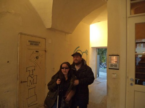 Tony, Tatiana, stood in a narrow passage between colourful old houses, Altstad (Old Town).