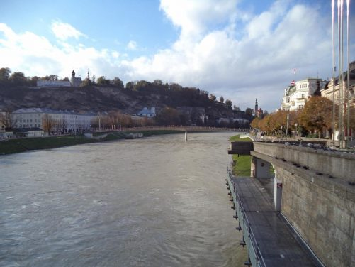 Another view along the Salzach river. On the opposite bank, cliffs can be seen rising up to a plateau. This wooded hill is known as Mönchsberg. It is a popular recreation area near the centre of city.