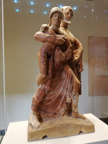 Late Archaic terracotta statue of Zeus carrying Ganymede.