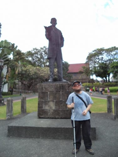 Bronze statue of José Rizal at Fort Santiago. He is depicted holding a book, reflecting the fact he was a writer and poet.