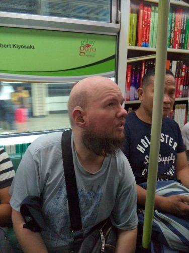 Tony onboard a tram.