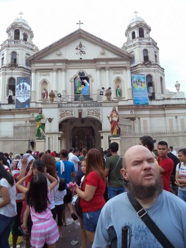 Again Tony outside the basilica with people queuing in the background.