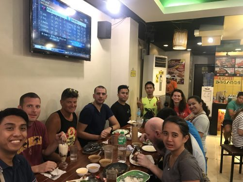 Tony and the other couchsurfers eating at a local Filipino restaurant in or near Intramuros.