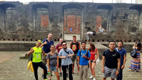 Tony and the other couchsurfers outside the ruins of a building at Fort Santiago. The fort was built by the Spanish beginning in 1590. It has a perimeter of 620 metres (2,030 feet) and it is of a nearly triangular form. During World War II the fort was used by the Japanese Imperial Army as the prison. It was badly damaged during the Battle of Manila in February 1945.