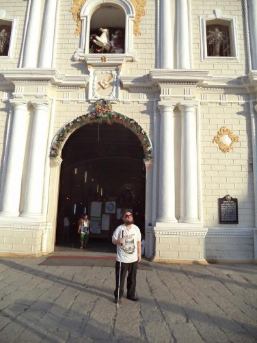 Tony outside the entrance to Vigan Cathedral.