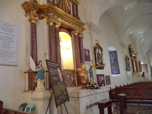 An altar along one of the side aisles. It is dedicated to Filipino Bishop Alfredo Versoza who died in 1954. He is venerated as a 'Servant of God', the first stage to possible canonization as a saint.