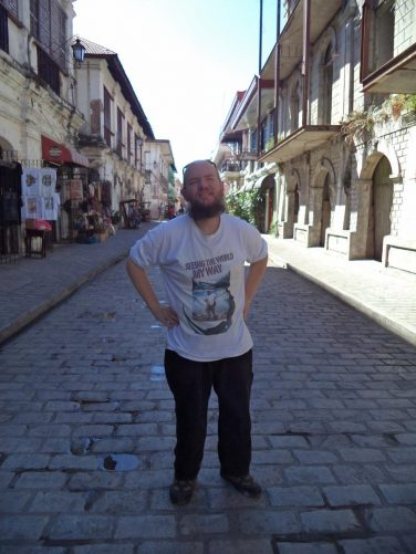 Tony in the middle of Calle Crisologo Street.