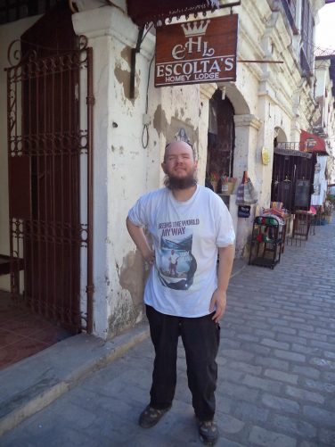 The following morning, Tony on Calle Crisologo Street outside Escolta's Homey Lodge.