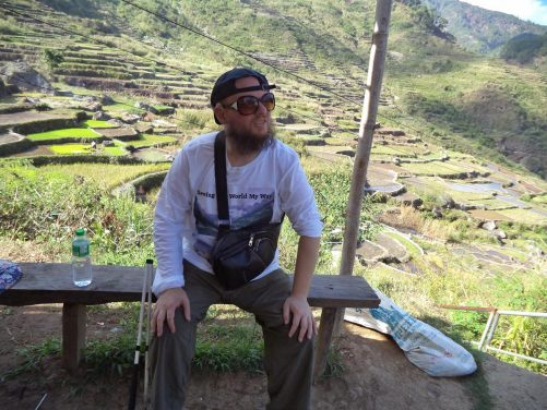 Tony sitting on a bench with another excellent view of the rice terraces behind.
